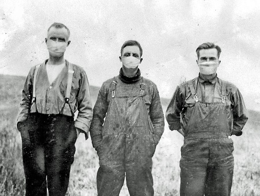 This historic photo depicts men wearing masks during the Spanish Influenza epidemic in 1918. The Woodstock Museum was surprised by the lack of local firsthand accounts and artifacts documenting the epidemic during the final year of the First World War. (Photo from Library and Archives Canada)
